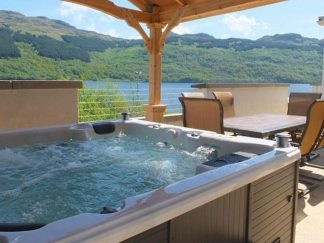 Hot tub view looking over loch in sunshine